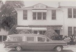 Original Settle Funeral Home with Ambulance/Hearse in front.