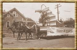 Harry W. Glover float with children and banners in Elks parade. Mr. Glover was an original Home Undertaking Company stockholder and former mayor of Redding.  photo