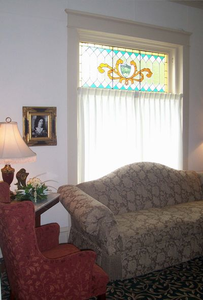 The front parlor sitting area welcomes friends to sit and visit with the family.
