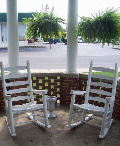 The front porch provides friends and families with a place to sit and talk.